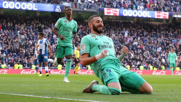 Karim Benzema celebrates scoring Real Madrid's second against Espanyol. Photograph: Gonzalo Arroyo Moreno/Getty