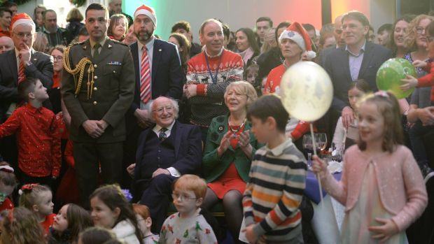 President Michael D Higgins and his wife Sabina at the centre of the crowd at Áras an Uachtaráin amid the tree-lighting ceremony ahead of the Christmas season. Photograph: Dara Mac Dónaill