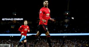 Manchester United's Marcus Rashford celebrates scoring his side's first goal  during the Premier League match against Manchester City  at the Etihad stadium. Photograph: Martin Rickett/PA Wire