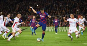 Luis Suarez scores Barcelona's fourth goal with a backheel during the La Liga match against Mallorca at  the Nou Camp. Photograph:  Alex Caparros/Getty Image