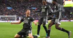 Jonny Evans celebrates after scoring Leicester's third goal in their rout of Aston Vikka. Photograph: Michael Regan/Getty