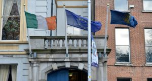 Flags over the door of the  Stephen's Green Hibernian Club, Dublin. Photograph: Dara Mac Dónaill / The Irish Times