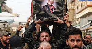 Iraqi mourners carry the coffin of a protester and citizen journalist killed at demonstrations in Baghdad. Photograph:  Haidar Hamdani/AFP