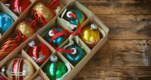 Back at Ma's old house, I climbed into the attic. In a cobwebby corner was a cardboard box, ancient, battered, packed to the gills with the Christmas trinkets I'd know since I was five. Every single gaudy bauble, every moth-eaten felt robin was there. Photograph: iStock