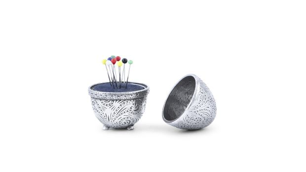 Silver egg-shaped nutmeg grater converted to a pin cushion €100-€200, Adam's At Home sale, December 15th