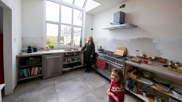 In the work-in-progress kitchen: Amy Walsh and daughter Emmy-Mae. Photograph: Patrick Browne