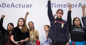 Sweden's Greta Thunberg (centre) with representatives of indigenous people  at the COP25 climate conference in Madrid, Spain. Photograph: Pablo Blazquez Dominguez/Getty Images