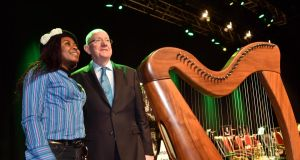 Mabel Chah from Cameroon  with Minister for Justice Charlie Flanagan after she received her Irish citizenship at the Citizenship Ceremony in the INEC, Killarney. Photograph: Don MacMonagle