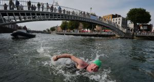 Dublin City Liffey Swim was threatened in 2019 by poor quality of water in river Liffey. Photograph: Alan Betson