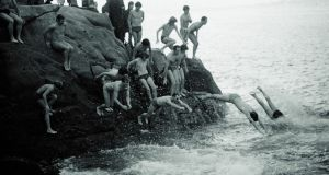 Taking a Christmas Day swim at the Forty Foot in 1971. Photograph: Dermot O'Shea/The Irish Times