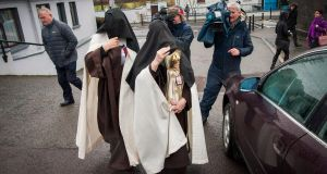 COURT APPEARANCE: Sr Irene Gibson, Carmelite Nun of the Holy Face of Jesus, leaving Skibbereen District Court carrying a Child of Prague statue, with Sr Anne Marie of the Holy Family Carmelite Hermitage, Leap, Co Cork. Photograph: Daragh Mc Sweeney/Cork Courts