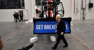 Conservative  leader Boris Johnson campaigning   at a JCB plant  in Uttoxeter, Staffordshire. Photograph:  Ben Stansall/pool/AFP via Getty Images