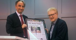 Irish Times editor Paul O'Neill presents former   parliamentary correspondent Michael O'Regan   with a special front page      to mark his recent retirement  from the newspaper after almost 40 years