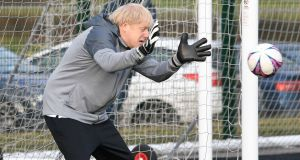Prime minister Boris Johnson tries his hand in goal before a football match between Hazel Grove Utd and Poynton Jnr u10s in the Cheshire Girls football league in Cheadle Hume, Cheshire. Photograph: Stefan Rousseau/PA Wire