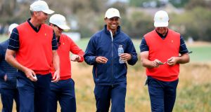 US team captain Tiger Woods with teammates Matt Kuchar and Gary Woodland during a practice round ahead of the Presidents Cup. Photograph: Getty Images