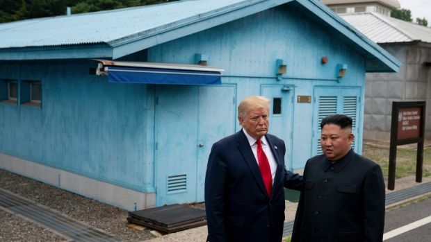 US president Donald Trump and North Korean leader Kim Jong-un stand on the South Korean side of the Demilitarized Zone between North and South Korea in June. Photograph: Erin Schaff/New York Times