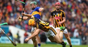 Kilkenny's Colin Fennelly tussels with Cathal Barrett of Tipperary during the All-Ireland final at  Croke Park. Photograph: Ryan Byrne/ Inpho
