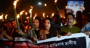 Students of Gauhati University take part in a torchlight procession against the Citizenship Amendment Bill   in Guwahati, Assam, India. Photograph: EPA