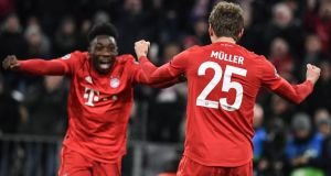 Thomas Muller celebrates with Alphonso Davies after scoring Bayern's second against Spurs. Photograph: Phillipp Guelland/EPA
