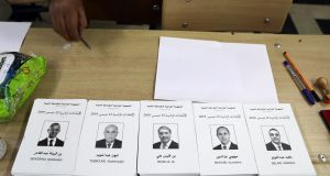 Ballot papers sit on a desk at a polling station in Algiers on Thursday. Photograph: Mohamed Messara/EPA