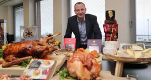 Giles Hurley, CEO of Aldi UK and Ireland, with the supermarket's Christmas food range at its divisional headquarters and logistics hub in Naas, Co Kildare. Photograph:   Nick Bradshaw