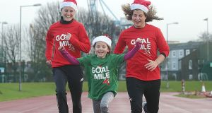 Champion middle-distance runner Ciara Mageean, and Irish rugby international Jenny Murphy, with Saoirse Moore, aged seven, from Sandymount at the launch of the 38th annual Goal Mile, Ireland's longest running fundraising event . Irishtown Stadium. Photograph: Damien Eagers