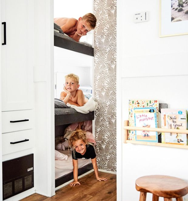 The three children of Ashley and Dino Petrone in their bunk-bed space in the couple's 2003 Keystone Cougar trailer, which is the family home in Ventura, California. Photograph: Sian Richards