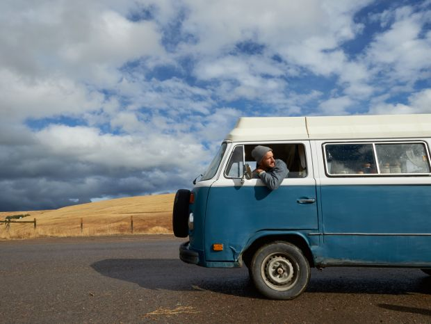 Nash Finley in his 1978 VW van, in which he and his partner, Kim, live, spending most of their time in the mountains of Montana. Photograph: Sian Richards
