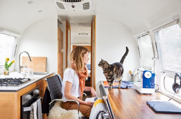 Quiltmaker Laura Preston with her cat Papa in her 1990 Airstream in California. Photograph: Sian Richards