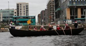 The Lagan Currach, the longest  currach in the world,  in action  on the River Liffey during the recent 'All In A Row' fundraiser.