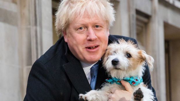 Britain's prime minister Boris Johnson leaves the polling station after casting his vote with his dog Dilyn, in London. Photograph: Vickie Flores/EPA