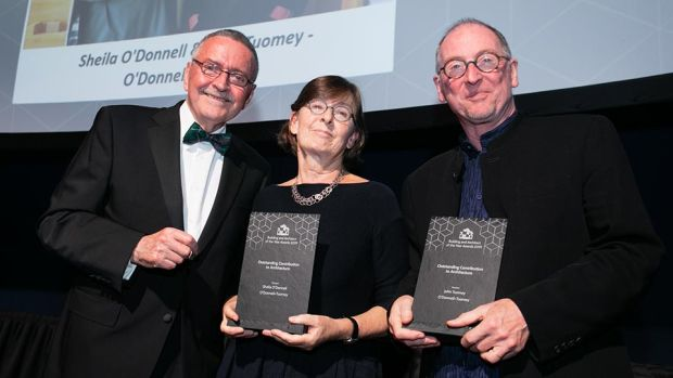 Frank McDonald, Awards Judging Co-ordinator presents the Outstanding Contribution to Architecture award to John Tuomey and Sheila O'Donnell - O'Donnell + Tuomey.