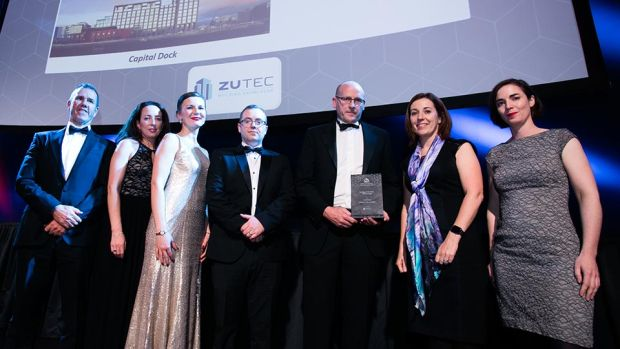 Clíona Farrelly, CEO, Zutec presents the Building of the Year - Office (Large) award to O'Mahony Pike Architects team.
