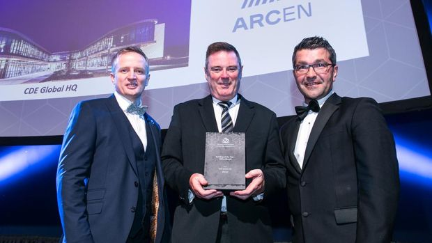 Martin Murray, Sales and Business Development Manager, Cabinpac presents the Building of the Year – Office (Small) award to Jason Arthur & Johnston Bell, ARCEN.