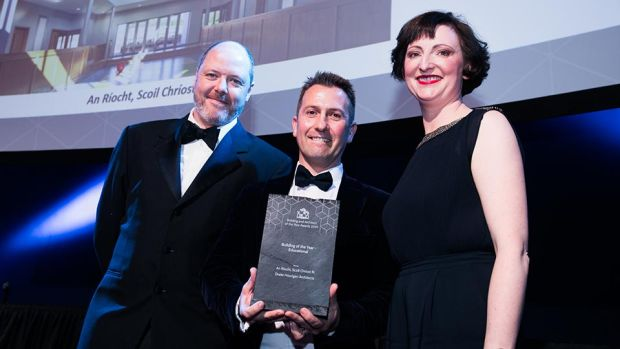 Stephen Pierce, Area Sales Manager, Vescom presents the Building of the Year - Educational award to Conor Hourigan & Ailish Drake, Drake Hourigan Architects.