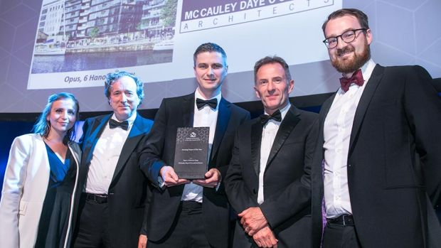 Derry Kearney, Awards Judge presents the Housing Project of the Year award to the McCauley Daye O'Connell Architects team.
