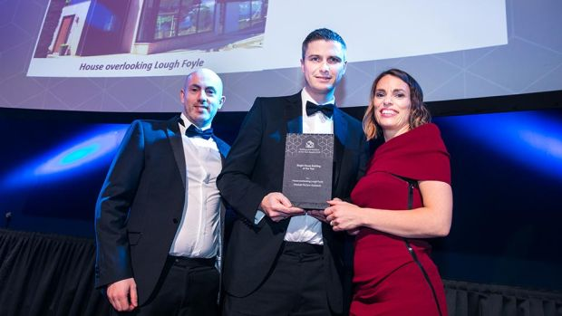 Derry Kearney, Awards Judge presents the Single House Building of the Year award to Martin Marshall & Roisin McCann, Marshall McCann Architects.