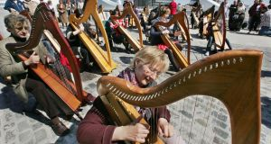A file image of a group of harpists taking part in an open air concert on the Samuel Beckett Bridge in Dublin. Unesco has recognised Irish harping as part of the world's 'living heritage'. Photograph: Matt Kavanagh/The Irish Times.