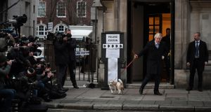 UK ELECTION: British prime minister Boris Johnson leaves after casting his vote with dog Dylan at Methodist Hall polling station in London. Photograph: Chris J Ratcliffe/Getty Images
