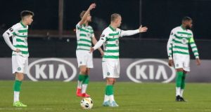 Celtic's players after CFR scored their opening goal at the Constantin Radulescu stadium. Photograph: AP