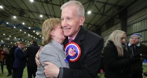 The DUP's Gregory Campbell celebrates his re-election in East Derry with his wife. Photograph: Niall Carson/PA Wire