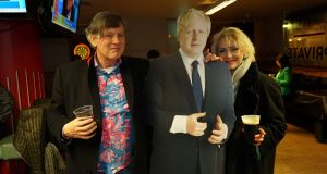 Conservative party supporters Johnnie Burke-Gaffney and Paula Jensen pose beside a cardboard cut-out of Boris Johnson as they celebrate the Tories' election win in London. Photograph: Enda O'Dowd