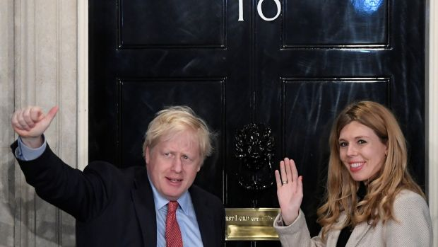 British prime minister Boris Johnson and his partner Carrie Symonds arrive at 10 Downing Street early on Friday after his general election win. Photograph: Reuters