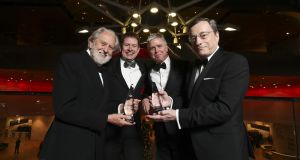 Oscar-winning Lord David Puttnam, left, Seamus Hand, managing partner KPMG, Ian Hyland, publisher Business & Finance Media and Mario Draghi, former president of the European Central Bank at the 45th annual Business & Finance Awards at the Convention Centre, Dublin. Mario Draghi received the Sutherland Leadership Award and Oscar-winning Lord David Puttnam received the TK Whitaker Award. Picture Conor McCabe
