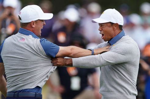 Playing captain Tiger Woods of the United States team and teammate Justin Thomas celebrate after defeating the International team during day two of the 2019 Presidents Cup golf tournament at the Royal Melbourne Golf Club in Melbourne, Australia. Photograph: Scott Barbour/EPA