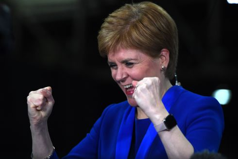 Scottish National Party (SNP) leader and Scotland's First Minister Nicola Sturgeon celebrates as she hears that new SNP MP for Dunbartonshire East, Amy Callaghan, has unseated Britain's Liberal Democrat leader Jo Swinson. Photograph: Andy Buchanan/Getty