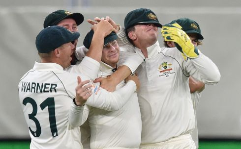 Australia's Steve Smith (third left) is mobbed by his team-mates after catching New Zealand captain Kane Williamson  on day two of the first Test cricket match between Australia and New Zealand at the Perth Stadium. Photograph: Peter Parks/Getty