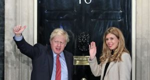 Prime minister Boris Johnson and his girlfriend Carrie Symonds arriving in Downing Street on Friday after the Conservative Party won an electoral landslide.  Photograph:  Yui Mok/PA Wire