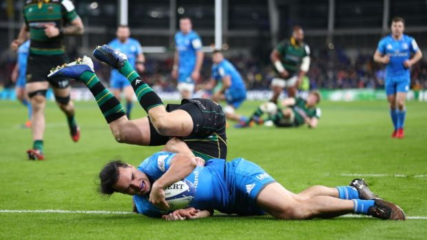 James Lowe scores a try despite the challenge from Dan Biggar. Photo: Michael Steele/Getty Images