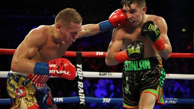 Vladimir Nikitin catches Michael Conlan during his defeat in New York. Photograph: Al Bello/Getty